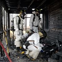 Fire Marshal Inspect a Burned Structure